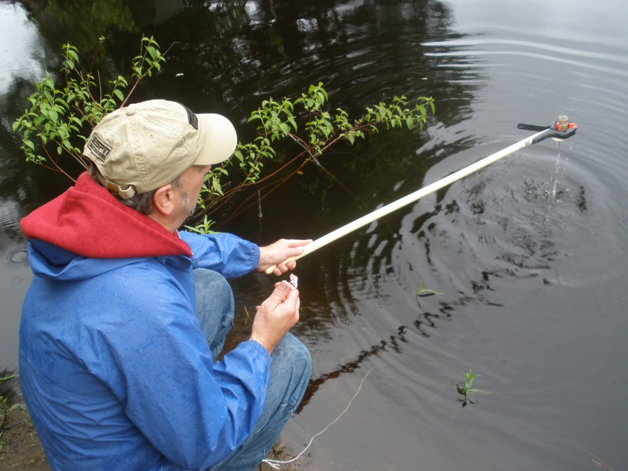 A volunteer samples the Millers River for bacteria by Ivan Ussach