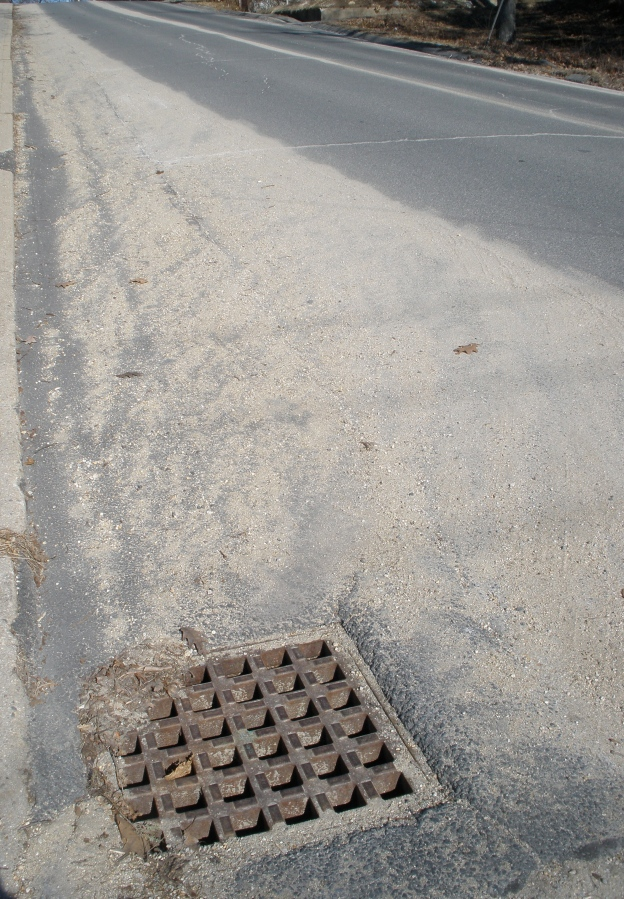 Sand and storm drain by Ivan Ussach